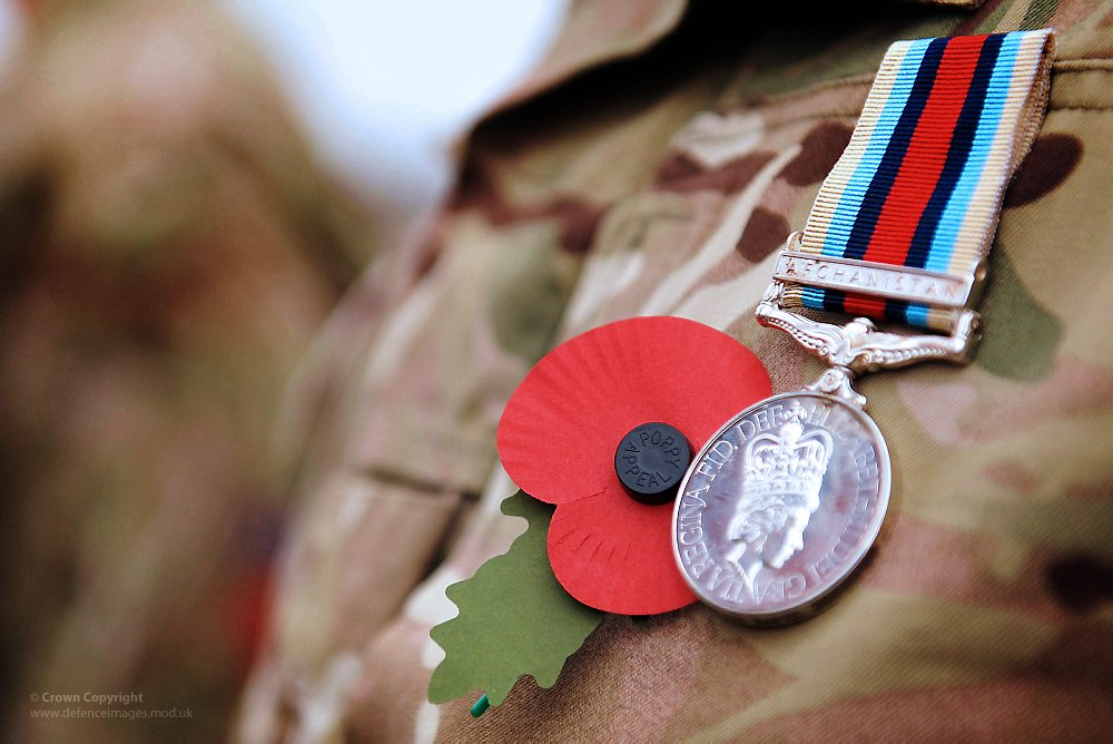 Image of soldier wearing Afghanistan medal and poppy - because if the unthinkable happens you need to be able to rely on your wishes being carried out