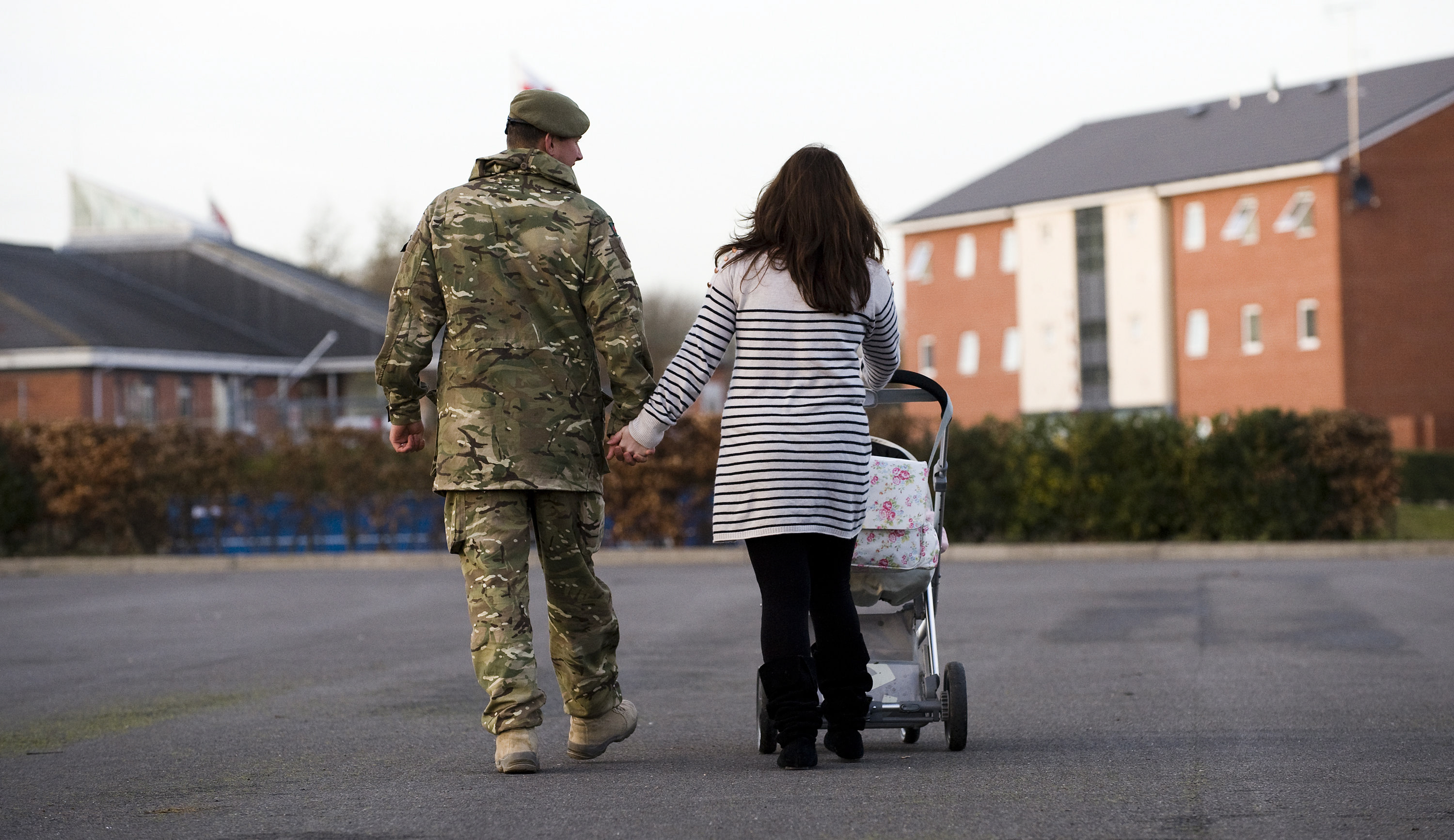 Picture of soldier returned home with young family and pushchair - family law issues sadly affect service personnel too